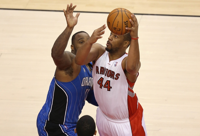 Jan 29, 2014; Toronto, Ontario, CAN; Toronto Raptors forward Chuck Hayes (44) goes to the basket against Orlando Magic forward Glen Davis (11) at Air Canada Centre. The Raptors beat the Magic 98-83. Mandatory Credit: Tom Szczerbowski-USA TODAY Sports