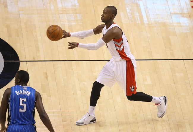 Jan 29, 2014; Toronto, Ontario, CAN; Toronto Raptors guard Terrence Ross (31) passes the ball against the Orlando Magic at Air Canada Centre. The Raptors beat the Magic 98-83. Mandatory Credit: Tom Szczerbowski-USA TODAY Sports