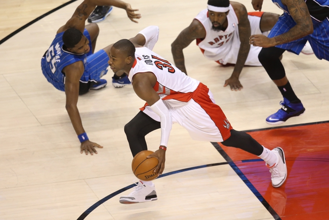 Jan 29, 2014; Toronto, Ontario, CAN; Toronto Raptors guard Terrence Ross (31) comes away with the ball against the Orlando Magic at Air Canada Centre. The Raptors beat the Magic 98-83. Mandatory Credit: Tom Szczerbowski-USA TODAY Sports