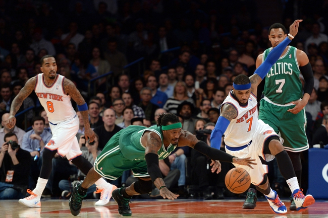 Jan 28, 2014; New York, NY, USA; Boston Celtics small forward Gerald Wallace (45) and New York Knicks small forward Carmelo Anthony (7) go after a loose ball during the first half at Madison Square Garden. Mandatory Credit: Joe Camporeale-USA TODAY Sports