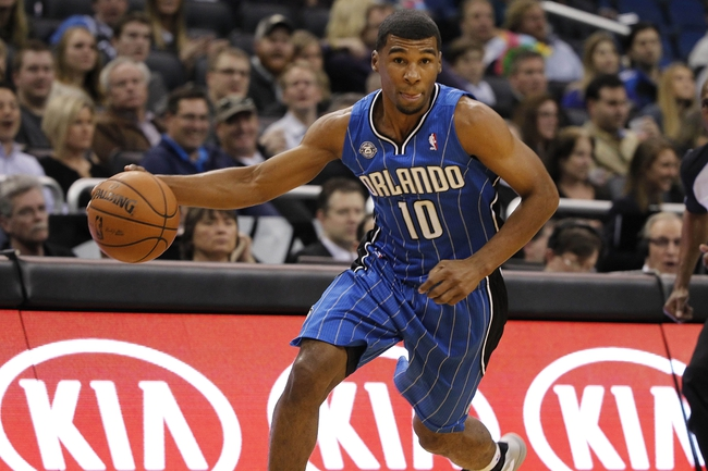 Jan 31, 2014; Orlando, FL, USA; Orlando Magic point guard Ronnie Price (10) dribbles the ball against the Milwaukee Bucks during the second half at Amway Center. Orlando Magic won 113-102.  Mandatory Credit: Kim Klement-USA TODAY Sports