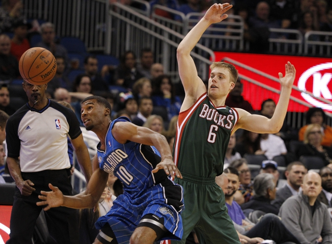 Jan 31, 2014; Orlando, FL, USA; Orlando Magic point guard Ronnie Price (10) defends Milwaukee Bucks point guard Nate Wolters (6) during the second half at Amway Center. Orlando Magic won 113-102.  Mandatory Credit: Kim Klement-USA TODAY Sports