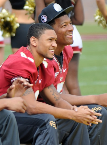 Feb 1, 2014; Tallahassee, FL, USA; Florida State Seminoles quarterback Jameis Winston (5) and wide receiver Rashad Greene (80) during the BCS National Championship Celebration at Doak Campbell Stadium. Mandatory Credit: Melina Vastola-USA TODAY Sports