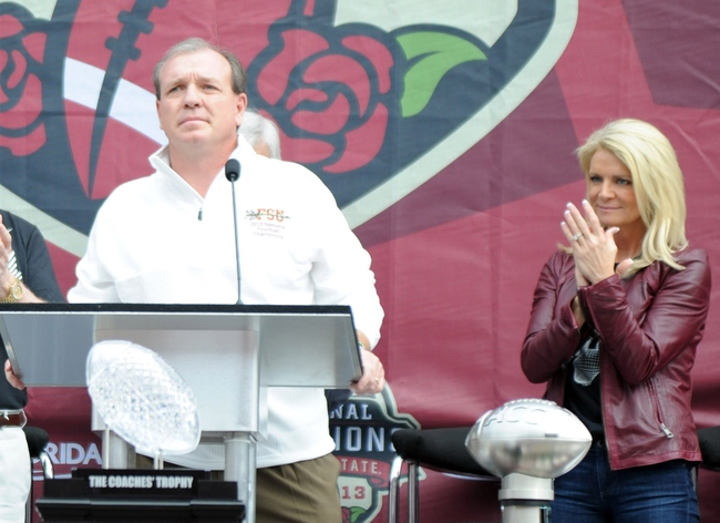 Feb 1, 2014; Tallahassee, FL, USA; Florida State Seminoles head coach Jimbo Fisher speaks as his wife Candi Fisher looks on during the BCS National Championship Celebration at Doak Campbell Stadium. Mandatory Credit: Melina Vastola-USA TODAY Sports