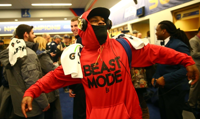 Feb 2, 2014; East Rutherford, NJ, USA; Seattle Seahawks running back Marshawn Lynch celebrates in the locker room after Super Bowl XLVIII against the Denver Broncos at MetLife Stadium.  Mandatory Credit: Mark J. Rebilas-USA TODAY Sports