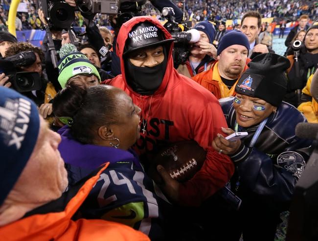Feb 2, 2014; East Rutherford, NJ, USA; Seattle Seahawks running back Marshawn Lynch celebrates after winning Super Bowl XLVIII against the Denver Broncos at MetLife Stadium. Seattle Seahawks won 43-8.  Mandatory Credit: Matthew Emmons-USA TODAY Sports