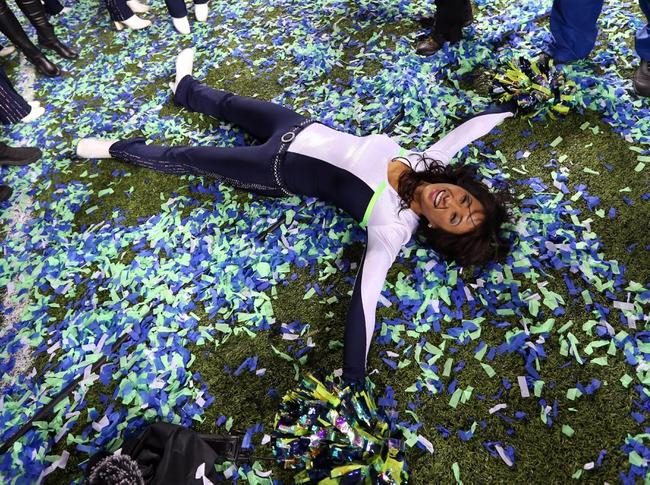 Feb 2, 2014; East Rutherford, NJ, USA; A Seattle Seahawks cheerleaders celebrates after winning Super Bowl XLVIII against the Denver Broncos at MetLife Stadium. Seattle Seahawks won 43-8.  Mandatory Credit: Matthew Emmons-USA TODAY Sports