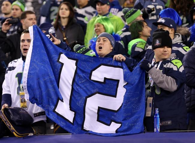 Feb 2, 2014; East Rutherford, NJ, USA; Seattle Seahawks fans celebrate after winning Super Bowl XLVIII against the Denver Broncos at MetLife Stadium. Seattle Seahawks won 43-8.  Mandatory Credit: Matthew Emmons-USA TODAY Sports