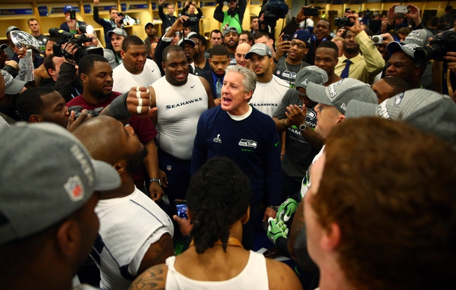 Feb 2, 2014; East Rutherford, NJ, USA; Seattle Seahawks head coach Pete Carroll celebrates in the locker room with his players after Super Bowl XLVIII against the Denver Broncos at MetLife Stadium.  Mandatory Credit: Mark J. Rebilas-USA TODAY Sports