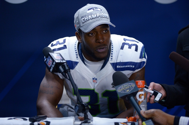 Feb 2, 2014; East Rutherford, NJ, USA; Seattle Seahawks strong safety Kam Chancellor (31) is interviewed after Super Bowl XLVIII against the Denver Broncos at MetLife Stadium.  Mandatory Credit: Kirby Lee-USA TODAY Sports