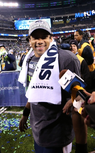 Feb 2, 2014; East Rutherford, NJ, USA; Seattle Seahawks quarterback Russell Wilson celebrates after defeating the Denver Broncos in Super Bowl XLVIII at MetLife Stadium.  Mandatory Credit: Matthew Emmons-USA TODAY Sports
