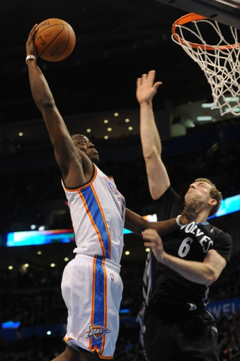 Feb 5, 2014; Oklahoma City, OK, USA; Oklahoma City Thunder point guard Reggie Jackson (15) dunks the ball as Minnesota Timberwolves small forward Robbie Hummel (6) defends during the fourth quarter at Chesapeake Energy Arena. Mandatory Credit: Mark D. Smith-USA TODAY Sports