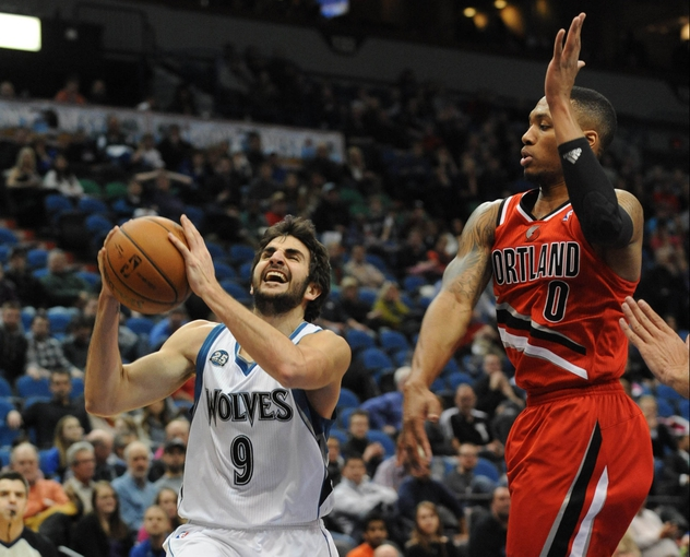 Feb 8, 2014; Minneapolis, MN, USA; Minnesota Timberwolves guard Ricky Rubio (9) moves past Portland Trail Blazers guard Damian Lillard (0) to shoot in the fourth quarter at Target Center.  The Trail Blazers defeated the Wolves  117-110.  Mandatory Credit: Marilyn Indahl-USA TODAY Sports