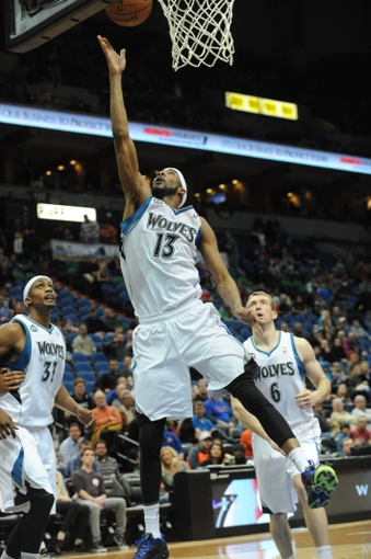 Feb 8, 2014; Minneapolis, MN, USA; Minnesota Timberwolves forward Corey Brewer (13) shoots in the fourth quarter against the Portland Trail Blazers at Target Center.  The Trail Blazers defeated the Wolves  117-110.  Mandatory Credit: Marilyn Indahl-USA TODAY Sports