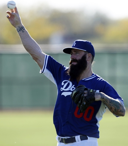 Feb 9, 2014; Glendale, AZ, USA; Los Angeles Dodgers pitchers Brian Wilson (00) warms up during the first day of camp at Camelback Ranch. Mandatory Credit: Rick Scuteri-USA TODAY Sports