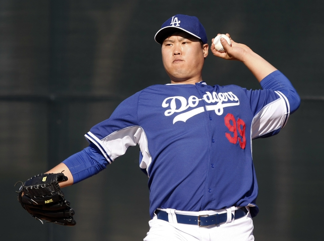 Feb 9, 2014; Glendale, AZ, USA; Los Angeles Dodgers starting pitcher Hyun-Jin Ryu (99) throws the ball during the first day of camp at Camelback Ranch. Mandatory Credit: Rick Scuteri-USA TODAY Sports