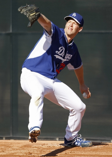 Feb 9, 2014; Glendale, AZ, USA; Los Angeles Dodgers starting pitcher Clayton Kershaw (22) throws the ball during the first day of camp at Camelback Ranch. Mandatory Credit: Rick Scuteri-USA TODAY Sports