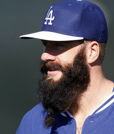 Feb 9, 2014; Glendale, AZ, USA; Los Angeles Dodgers pitchers Brian Wilson (00) looks on during the first day of camp at Camelback Ranch. Mandatory Credit: Rick Scuteri-USA TODAY Sports