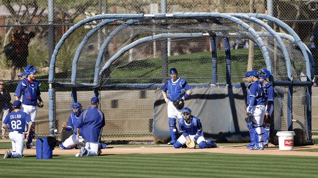 Feb 9, 2014; Glendale, AZ, USA; Los Angeles Dodgers catchers run drills during the first day of camp at Camelback Ranch. Mandatory Credit: Rick Scuteri-USA TODAY Sports
