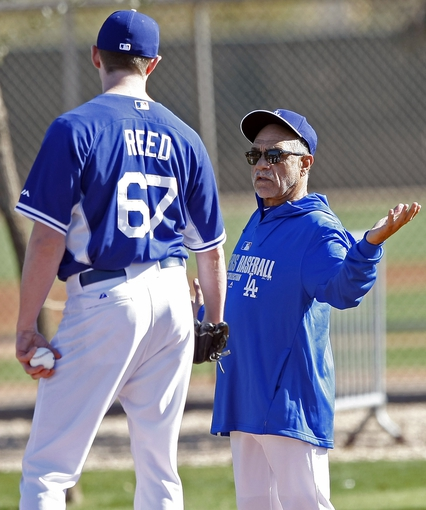 Feb 9, 2014; Glendale, AZ, USA; Los Angeles Dodgers coach Davey Lopes talks to pitcher Chris Reed (67) during the first day of camp at Camelback Ranch. Mandatory Credit: Rick Scuteri-USA TODAY Sports