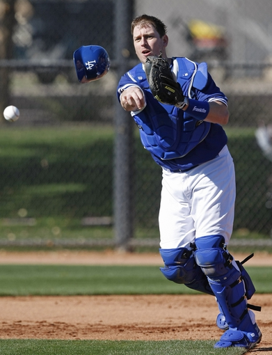 Feb 9, 2014; Glendale, AZ, USA; Los Angeles Dodgers catcher A.J. Ellis (17) throws the ball during the first day of camp at Camelback Ranch. Mandatory Credit: Rick Scuteri-USA TODAY Sports