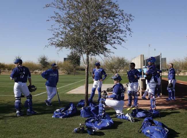 Feb 9, 2014; Glendale, AZ, USA; Los Angeles Dodgers catchers take a break during the first day of camp at Camelback Ranch. Mandatory Credit: Rick Scuteri-USA TODAY Sports