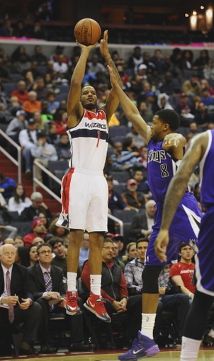 Feb 9, 2014; Washington, DC, USA; Washington Wizards small forward Trevor Ariza (1) shoots over Sacramento Kings small forward Rudy Gay (8) during the first half at Verizon Center. Mandatory Credit: Brad Mills-USA TODAY Sports