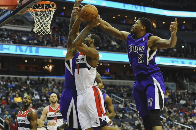 Feb 9, 2014; Washington, DC, USA; Sacramento Kings small forward Rudy Gay (8) blocks the shot attempt by Washington Wizards small forward Trevor Ariza (1) during the first half at Verizon Center. Mandatory Credit: Brad Mills-USA TODAY Sports