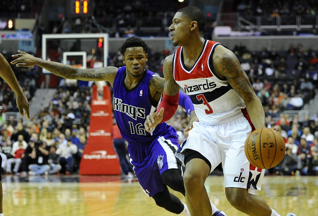 Feb 9, 2014; Washington, DC, USA; Washington Wizards shooting guard Bradley Beal (3) dribbles past Sacramento Kings shooting guard Ben McLemore (16) during the first half at Verizon Center. Mandatory Credit: Brad Mills-USA TODAY Sports