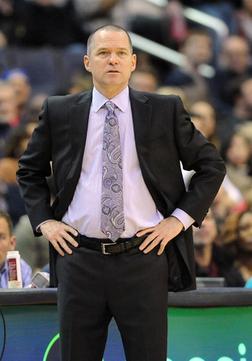 Feb 9, 2014; Washington, DC, USA; Sacramento Kings head coach Michael Malone on the sidelines against the Washington Wizards during the first half at Verizon Center. Mandatory Credit: Brad Mills-USA TODAY Sports