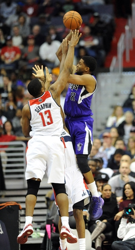 Feb 9, 2014; Washington, DC, USA; Sacramento Kings small forward Rudy Gay (8) shoots over Washington Wizards center Kevin Seraphin (13) during the first half at Verizon Center. Mandatory Credit: Brad Mills-USA TODAY Sports