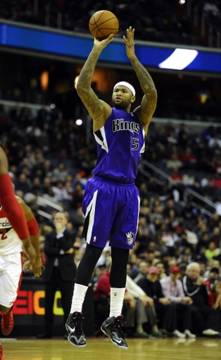 Feb 9, 2014; Washington, DC, USA; Sacramento Kings center DeMarcus Cousins (15) attempts a shot against the Washington Wizards during the second half at Verizon Center. The Wizards defeated the Kings 93 - 84. Mandatory Credit: Brad Mills-USA TODAY Sports