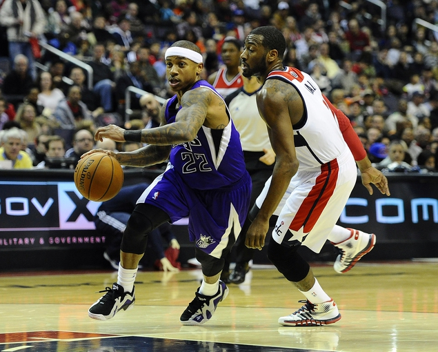 Feb 9, 2014; Washington, DC, USA; Sacramento Kings point guard Isaiah Thomas (22) dribbles as Washington Wizards point guard John Wall (2) looks on during the second half at Verizon Center. The Wizards defeated the Kings 93 - 84. Mandatory Credit: Brad Mills-USA TODAY Sports