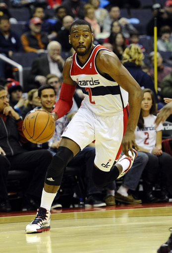 Feb 9, 2014; Washington, DC, USA; Washington Wizards point guard John Wall (2) dribbles against the Sacramento Kings during the first half at Verizon Center. Mandatory Credit: Brad Mills-USA TODAY Sports