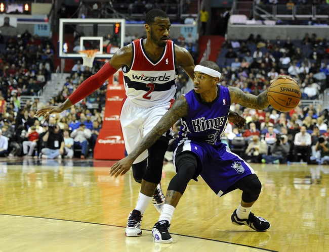 Feb 9, 2014; Washington, DC, USA; Sacramento Kings point guard Isaiah Thomas (22) dribbles as Washington Wizards point guard John Wall (2) defends during the second half at Verizon Center. The Wizards defeated the Kings 93 - 84. Mandatory Credit: Brad Mills-USA TODAY Sports