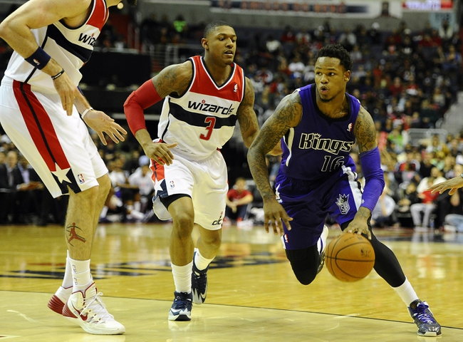 Feb 9, 2014; Washington, DC, USA; Sacramento Kings shooting guard Ben McLemore (16) dribbles as Washington Wizards shooting guard Bradley Beal (3) and Washington Wizards center Marcin Gortat (4) defend during the second half at Verizon Center. The Wizards defeated the Kings 93 - 84. Mandatory Credit: Brad Mills-USA TODAY Sports