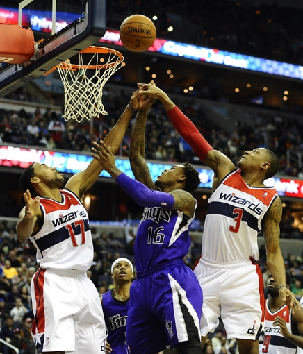 Feb 9, 2014; Washington, DC, USA; Sacramento Kings shooting guard Ben McLemore (16) attempts a shot as Washington Wizards shooting guard Garrett Temple (17) and Washington Wizards shooting guard Bradley Beal (3) defend during the second half at Verizon Center. The Wizards defeated the Kings 93 - 84. Mandatory Credit: Brad Mills-USA TODAY Sports