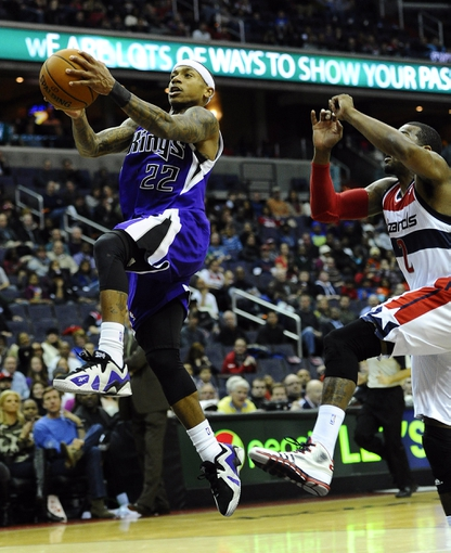 Feb 9, 2014; Washington, DC, USA; Sacramento Kings point guard Isaiah Thomas (22) shoots a layup against the Washington Wizards during the second half at Verizon Center. The Wizards defeated the Kings 93 - 84. Mandatory Credit: Brad Mills-USA TODAY Sports