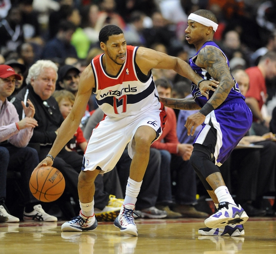 Feb 9, 2014; Washington, DC, USA; Washington Wizards shooting guard Garrett Temple (17) dribbles as Sacramento Kings point guard Isaiah Thomas (22) defends during the second half at Verizon Center. The Wizards defeated the Kings 93 - 84. Mandatory Credit: Brad Mills-USA TODAY Sports