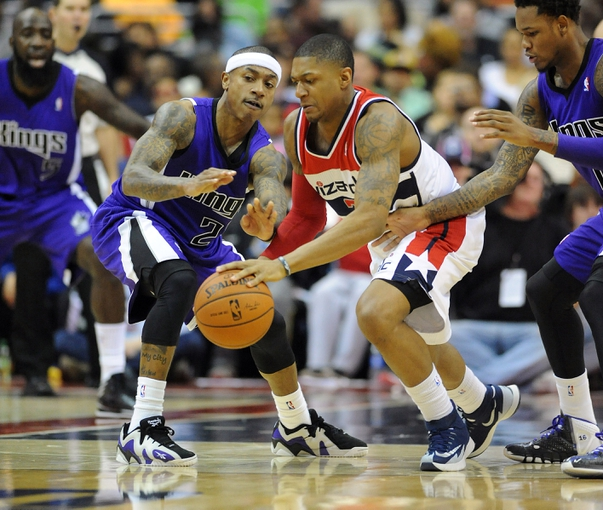 Feb 9, 2014; Washington, DC, USA; Washington Wizards shooting guard Bradley Beal (3) and Sacramento Kings point guard Isaiah Thomas (22) battle for a loose ball during the second half at Verizon Center. The Wizards defeated the Kings 93 - 84. Mandatory Credit: Brad Mills-USA TODAY Sports