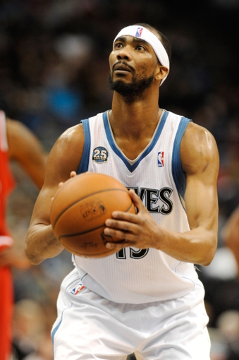 Feb 8, 2014; Minneapolis, MN, USA; Minnesota Timberwolves forward Corey Brewer (13) shoots a free throw in the second half against the Portland Trail Blazers at Target Center. The Trail Blazers defeated the Wolves  117-110.  Mandatory Credit: Marilyn Indahl-USA TODAY Sports