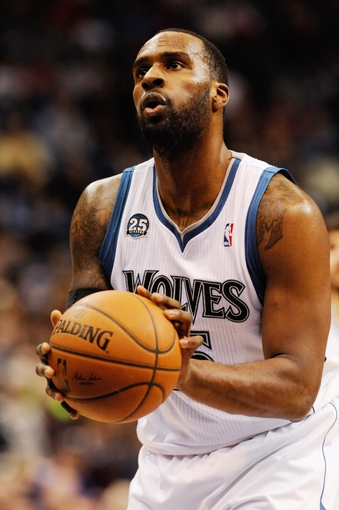 Feb 8, 2014; Minneapolis, MN, USA; Minnesota Timberwolves forward Shabazz Muhammad (15) shoots a free throw in the second half against the Portland Trail Blazers at Target Center. The Trail Blazers defeated the Wolves  117-110.  Mandatory Credit: Marilyn Indahl-USA TODAY Sports