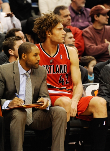 Feb 8, 2014; Minneapolis, MN, USA; Portland Trail Blazers center Robin Lopez (42) on the bench in the second half against the Minnesota Timberwolves at Target Center. The Trail Blazers defeated the Wolves  117-110.  Mandatory Credit: Marilyn Indahl-USA TODAY Sports