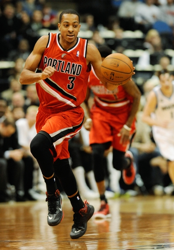 Feb 8, 2014; Minneapolis, MN, USA; Portland Trail Blazers guard C.J. McCollum (3) breaks away with the steal in the first half at Target Center. The Trail Blazers defeated the Wolves  117-110.  Mandatory Credit: Marilyn Indahl-USA TODAY Sports