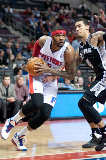 Feb 10, 2014; Auburn Hills, MI, USA; Detroit Pistons small forward Josh Smith (6) goes to the basket against San Antonio Spurs shooting guard Danny Green (4) during the first quarter at The Palace of Auburn Hills. Mandatory Credit: Tim Fuller-USA TODAY Sports
