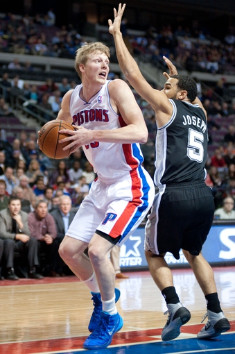 Feb 10, 2014; Auburn Hills, MI, USA; San Antonio Spurs point guard Cory Joseph (5) guards Detroit Pistons small forward Kyle Singler (25) during the first quarter at The Palace of Auburn Hills. Mandatory Credit: Tim Fuller-USA TODAY Sports