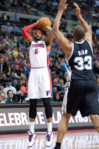 Feb 10, 2014; Auburn Hills, MI, USA; Detroit Pistons small forward Josh Smith (6) shoots over San Antonio Spurs power forward Boris Diaw (33) during the second quarter at The Palace of Auburn Hills. Mandatory Credit: Tim Fuller-USA TODAY Sports
