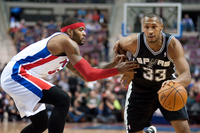 Feb 10, 2014; Auburn Hills, MI, USA; San Antonio Spurs power forward Boris Diaw (33) drives to the basket against Detroit Pistons small forward Josh Smith (6) during the third quarter at The Palace of Auburn Hills. Pistons won 109-100. Mandatory Credit: Tim Fuller-USA TODAY Sports