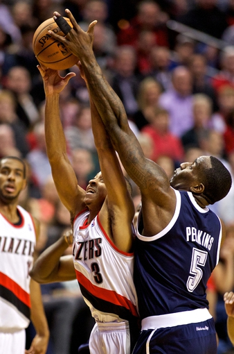 Feb 11, 2014; Portland, OR, USA; Oklahoma City Thunder center Kendrick Perkins (5) and Portland Trail Blazers shooting guard C.J. McCollum (3) fight for a rebound during the second quarter at the Moda Center. Mandatory Credit: Craig Mitchelldyer-USA TODAY Sports