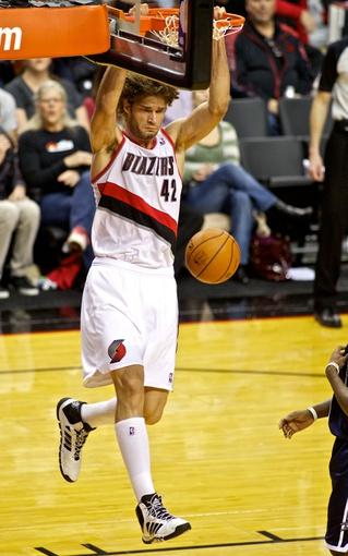 Feb 11, 2014; Portland, OR, USA; Portland Trail Blazers center Robin Lopez (42) dunks against the Oklahoma City Thunder during the third quarter at the Moda Center. Mandatory Credit: Craig Mitchelldyer-USA TODAY Sports